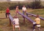 Martin O'Neil enjoys teeter tottering with the kids in the Bear Paw Mountains.