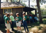 The McLain clan visits outside a camp cabin.