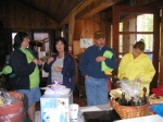 Judy and Martin O'Neil check out the raffle baskets at the front door of the Lodge.
