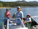 Connie Anderson, Mary Ann Moog, and Patty Smith go for a cruise on the lake.