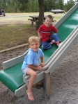 Nate Evans and his friend have great fun on the slide.