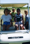 Luanne McLain drives the refreshment golf cart duirng the golf tournament.