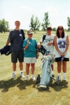 Kurt Fossen, Sally Cole, and their golf foursome enjoy the sunshine at the Beaver Creek Golf Course near Havre, Montana.