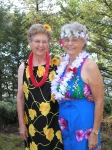 Thelma McLain and Ann LaCroix dress up for the Hawaiian celebration.