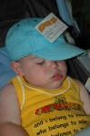 Young McLain catches a few Z's while his Mom works in the kitchen.